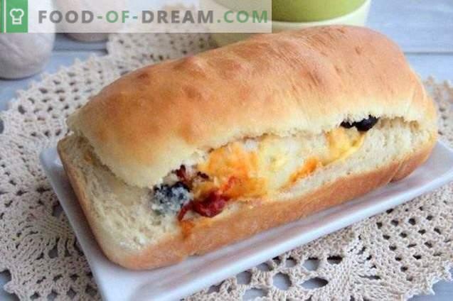 Kuchenrolle mit Oliven, getrockneten Paprika und Käse