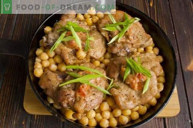Köstliches Schweinefleisch mit Kichererbsen und Zwiebeln im Ofen