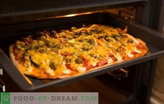 Das Pizza-Rezept im Ofen ist ein Lieblingsgericht zu Hause. Pizza-Rezepte im Ofen: mit Käse, Champignons, Schinken, Meeresfrüchten