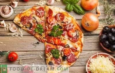 Pizza mit Tomaten, Wurst und Käse ist ein universelles Gericht für alle Gelegenheiten. Die besten Rezepte für eine appetitanregende Pizza mit Tomaten, Wurst und Käse